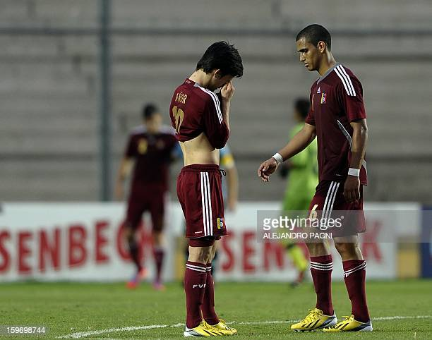 Venezuelan footballers show their dejection at the end of their South American U-20 Championship Group B football match against Uruguay, at...