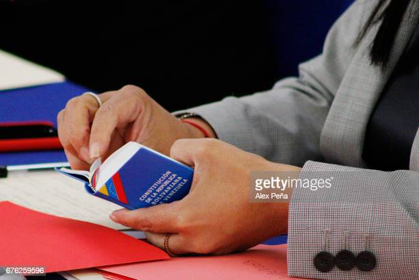 Venezuelan Foreign Minister Delcy Rodriguez reads the Constitution of the Bolivarian Republic of Venezuela during Meeting of Foreign Ministers and...