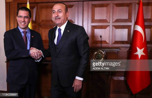 Venezuelan Foreign Minister Jorge Arreaza and Turkish Foreign Minister Mevlut Cavusoglu shake hands during a joint press conference following their...