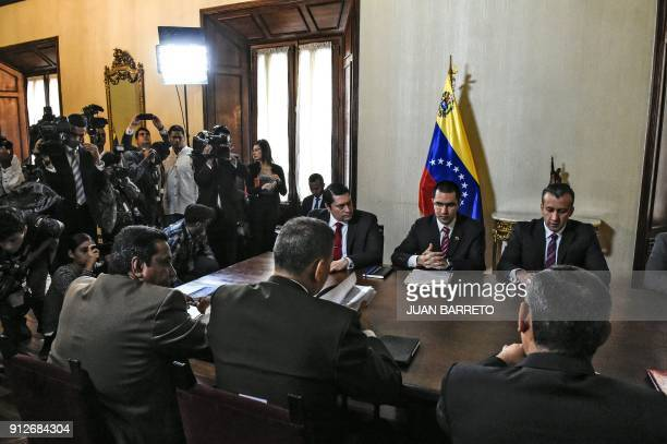 Venezuelan Foreign Minister Jorge Arreaza and Venezuelan Vice-President Tareck El Aissami attend a meeting with ministers in Caracas on Jaunuary 31,...