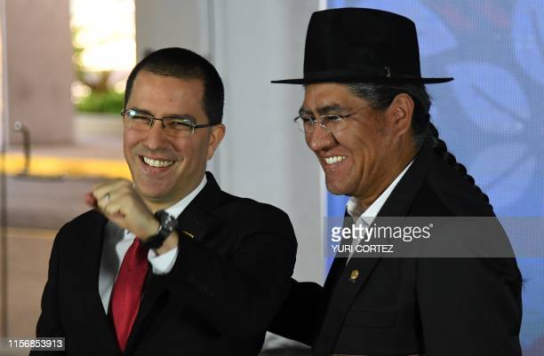 Venezuelan Foreign Minister Jorge Arreaza greets his Bolivian counterpart Diego Pary upon arrival at a hotel for the opening ceremony of the...