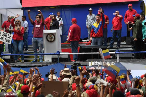 Venezuelan Foreign Minister Jorge Arreaza greets the crowd during a demonstration to back up the decision of ruling PSUV to leave OAS on April 27...