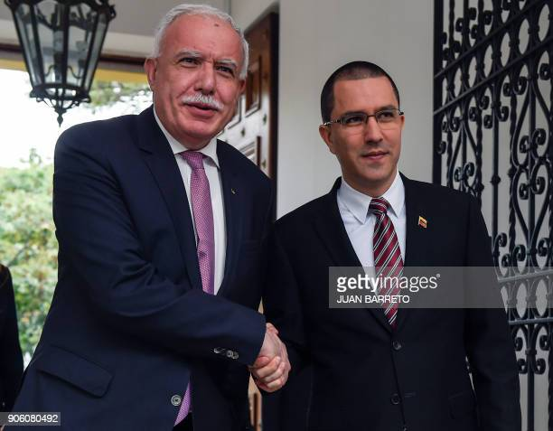 Venezuelan Foreign Minister Jorge Arreaza shakes hands with the Foreign Minister of the Palestinian Authority Riyad alMalk before a meeting in...
