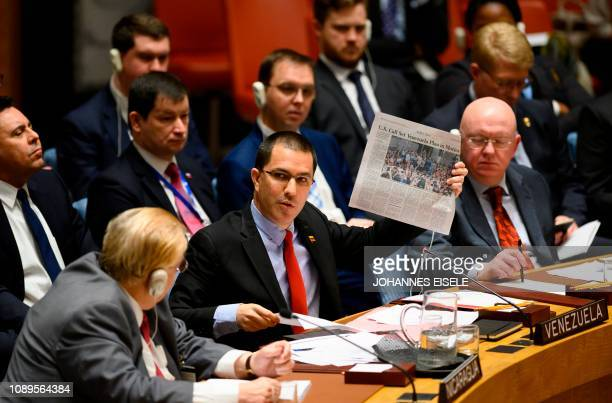 Venezuelan Foreign Minister Jorge Arreaza shows a newspaper as he speaks to the United Nations Security Council meeting on the situation in Venezuela...