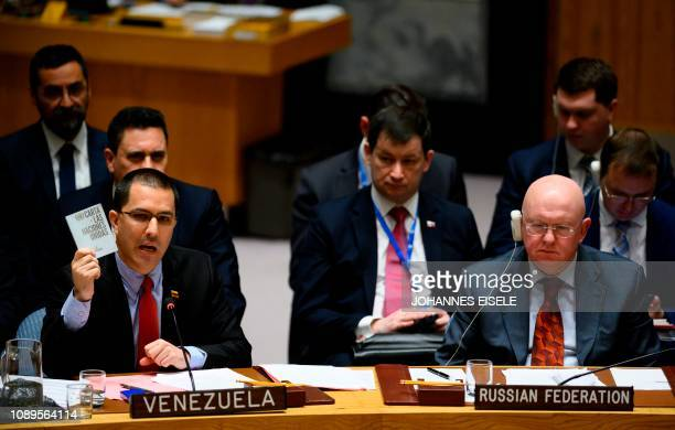 Venezuelan Foreign Minister Jorge Arreaza shows the Charter of the United Nations next to Russian Ambassador to the United Nations Vasily Nebenzya as...