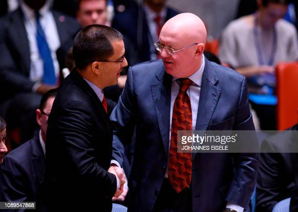 Venezuelan Foreign Minister Jorge Arreaza speaks to Russian Ambassador to the United Nations Vasily Nebenzya at a United Nations Security Council...