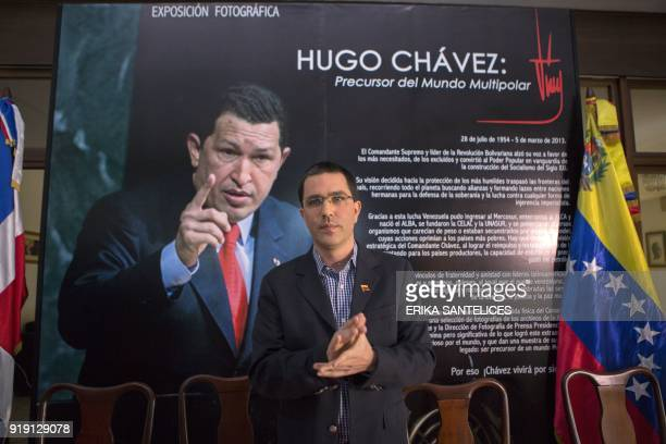 Venezuelan Foreign Minister Jorge Arreaza stands in front of a poster of late Venezuelan President Hugo Chavez during an event at the Venezuelan...