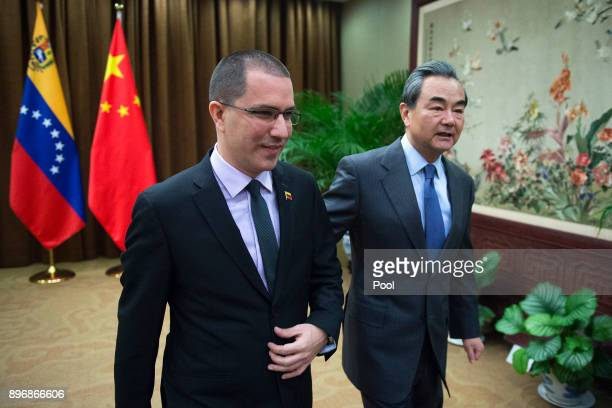 Venezuelan Foreign Minister Jorge Arreaza walks with China's Foreign Minister Wang Yi at the Ministry of Foreign Affairs in Beijing on December 22...