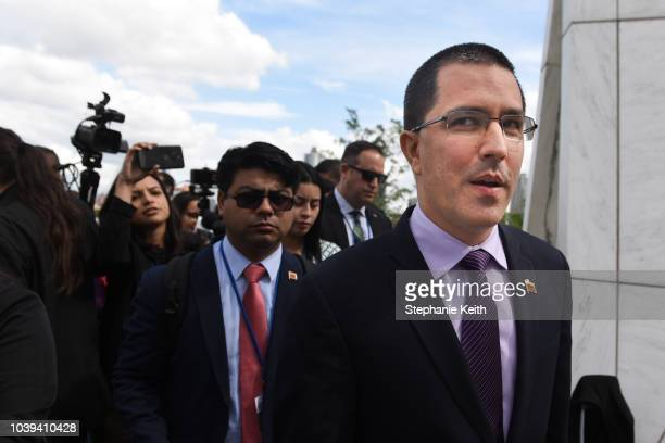 Venezuelan Foreign Minister Jorge Arreaza walks with his team after addressing the media at the United Nations during the United Nations General...