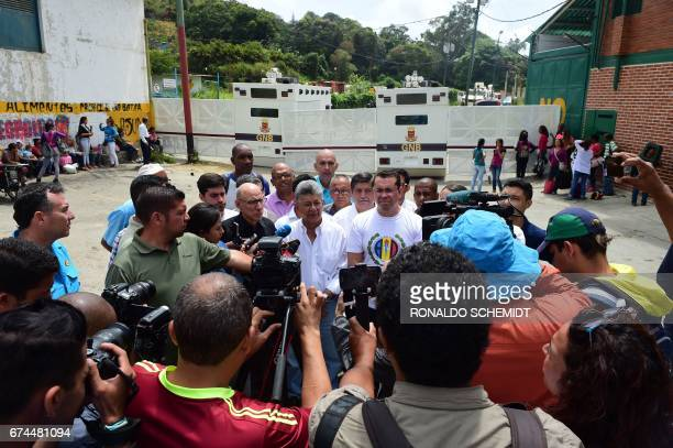Venezuelan former National Assembly president Henry Ramos Allup speaks with the press in front of National Guard riot control vehicles blocking the...