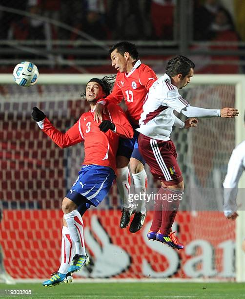 Venezuelan forward Giancarlo Maldonado vies for the ball with Chilean defender Waldo Ponce and midfielder Gary Medel during their 2011 Copa America...