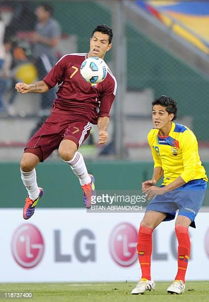 Venezuelan forward Nicolas Fedor is marked by Ecuadorean defender Norberto Araujo during a 2011 Copa America Group B first round football match held...