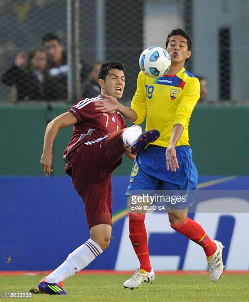 Venezuelan forward Nicolas Fedor vies for the ball with Ecuadorean defender Norberto Araujo during a 2011 Copa America Group B first round football...