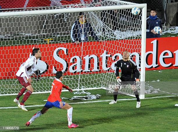 Venezuelan goalkeeper Renny Vega defender Gabriel Cichero and Chilean forward Alexis Sanchez eye the ball during their 2011 Copa America quarterfinal...
