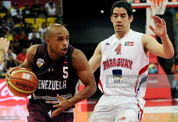 Venezuelan Gregory Vargas tries to dribble past Paraguayan Luis Ljubetich during their 2014 FIBA Basketball World Cup qualifier game on August 31 in...