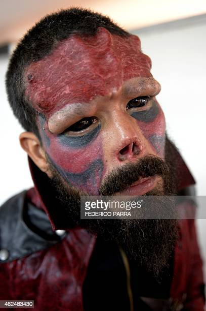 "Venezuelan Henry, known as ""Red Skull"", poses during the ""Expo Tatoo Venezuela"" in Caracas on January 29, 2015. AFP PHOTO/FEDERICO PARRA"