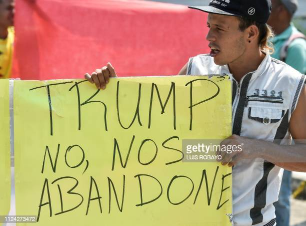 A Venezuelan holds a placard reading Trump Don't Leave Us during a protest against the government of President Nicolas Maduro at the Tienditas...
