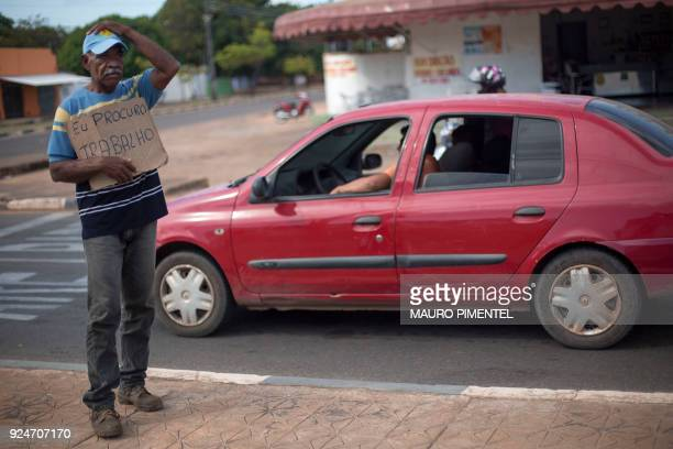 Venezuelan house painter Jose Ojeda stands in a traffic light with a sign reading in portuguese I look for a job in the city of Boa Vista Roraima...