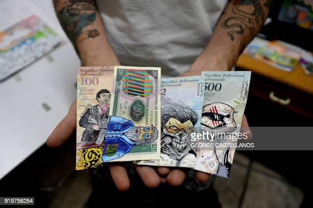 Venezuelan illustrator Jose Leon shows his artworks painted on devalued Bolivar bills, at his workshop in San Cristobal, Venezuela on February 2,...