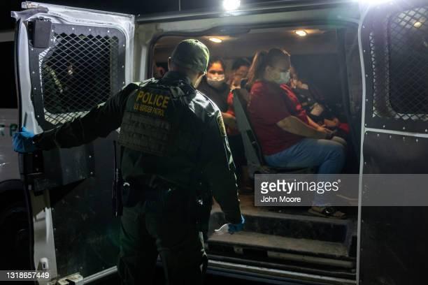 Venezuelan immigrants board a U.S. Border Patrol vehicle after crossing the Rio Grande on May 18, 2021 in Del Rio, Texas. They had crossed the...