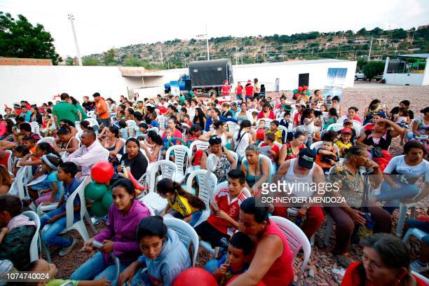 Venezuelan immigrants gather in Cucuta Colombia on the border with Venezuela where the Colombian Foreign Ministry is to give out gifts to Venezuelan...