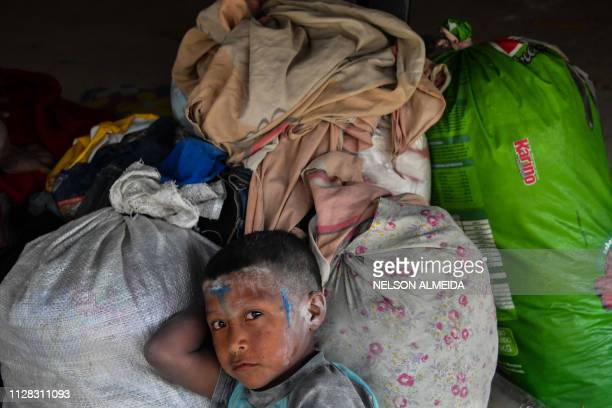 A Venezuelan indigenous child of the Warao tribe rests at the Janokoida shelter where they have been taking refuge in Pacaraima Roraima State Brazil...