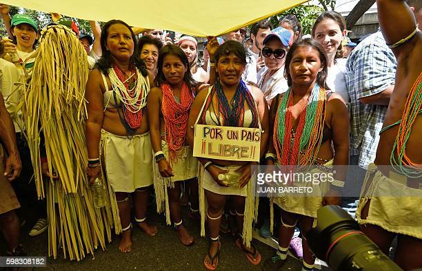 Venezuelan indigenous people take part in an opposition march in Caracas on September 1 2016 Venezuela's opposition and government head into a...