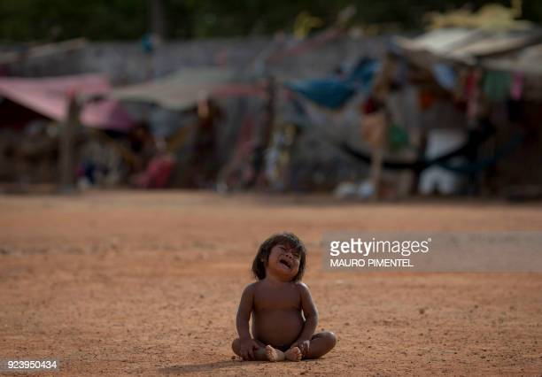 Venezuelan indigenous refugee child cries at the Pintolandia shelter in the city of Boa Vista Roraima Brazil on February 24 2018 According with local...