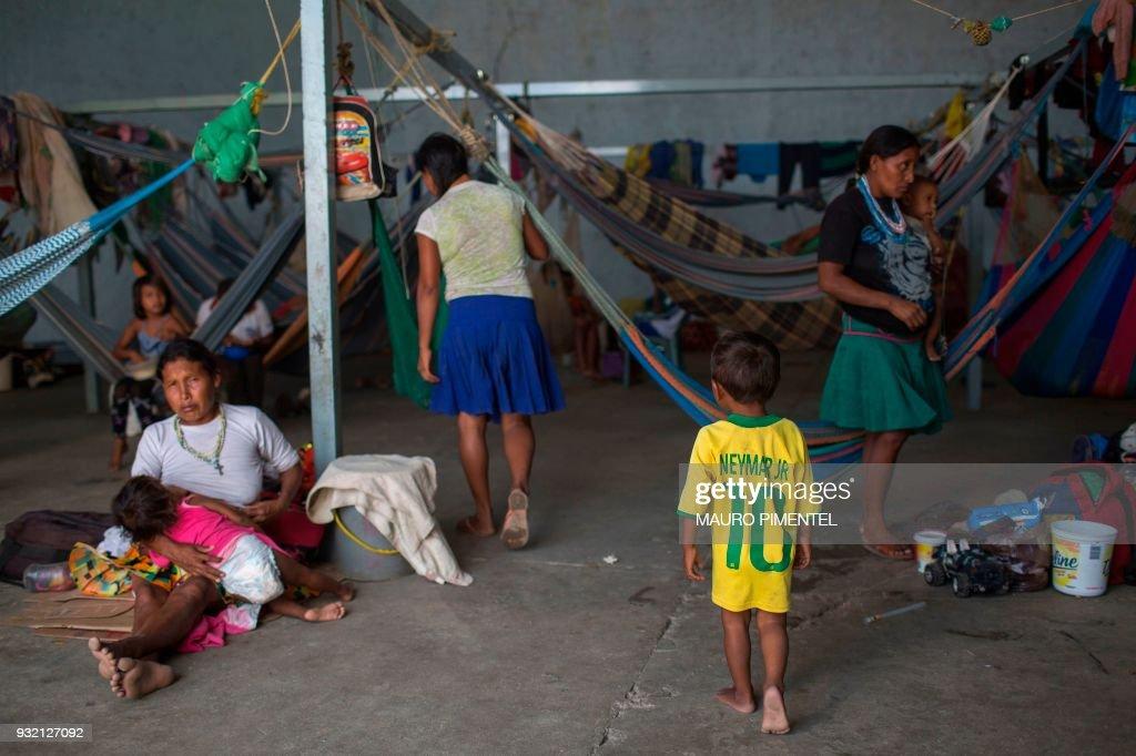 Venezuelan indigenous refugees rest inside a temporary ...
