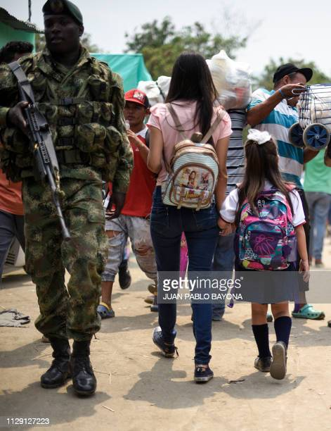 Venezuelan Leidy Navarro walks with her daughter Valentina Caceres back to their home in Urena Venezuela after picking her up at school in Cucuta...