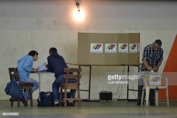 Venezuelan man cast his vote at a polling station during presidential elections in Barquisimeto on May 20, 2018 - Venezuelans headed to the polls...