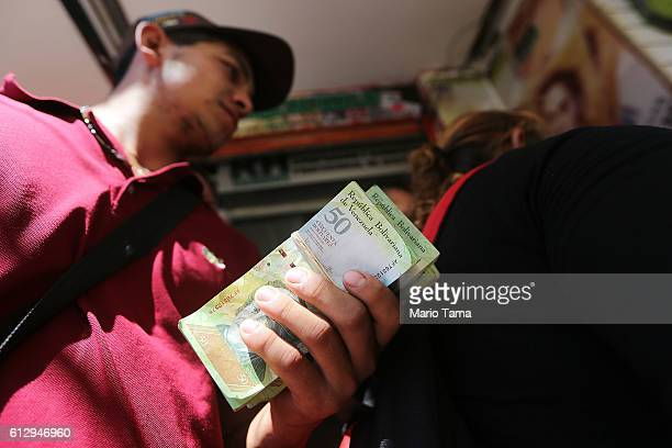 Venezuelan man waits to exchange bolivars the currency of Venezuela into Colombian pesos in order to purchase Colombian goods on October 4 2016 in...