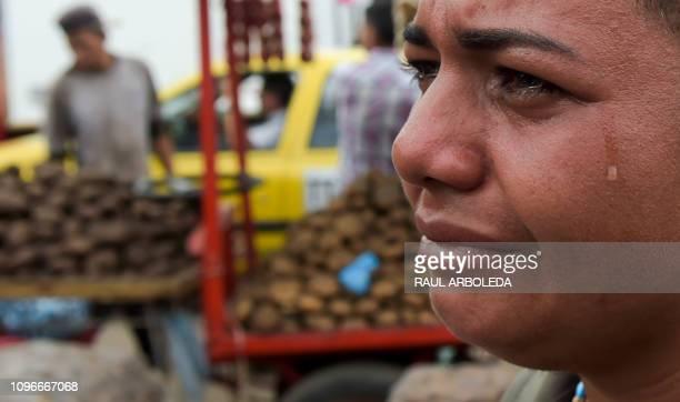 Venezuelan Maria Florez cries during an interview with AFP in the La Parada neighborhood in Cucuta Colombia near the Simon Bolivar International...