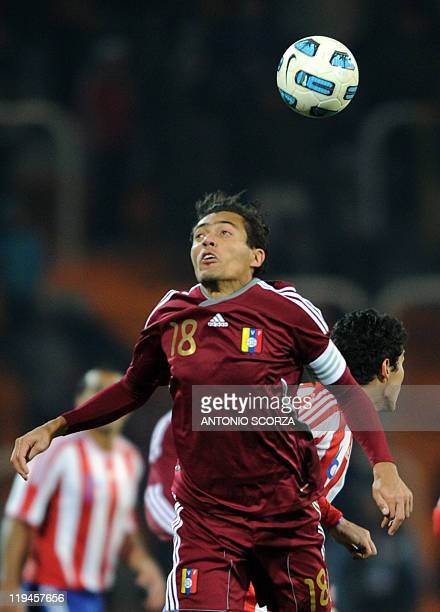 Venezuelan midfielder Juan Arango heads the ball during the 2011 Copa America semifinal football match against Venezuela at the Malvinas Argentinas...