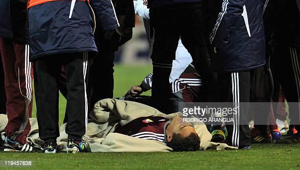 Venezuelan midfielder Juan Arango lies on the ground before the start of extra time during their 2011 Copa America semifinal football match against...
