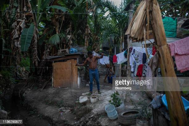 Venezuelan migrant cleans sewage at a makeshift shelter near the Venezuelan border in Pacaraima, Brazil, on Wednesday, April 10, 2019. Venezuelan...
