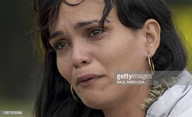 Venezuelan migrant Lulexis Gonzalez cries after stopping on the road from Cucuta to Pamplona in Norte de Santander Department Colombia on February 10...