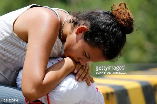 A Venezuelan migrant rests on the road from Cucuta to Pamplona in Norte de Santander Department Colombia on September 15 2018 The head of the...