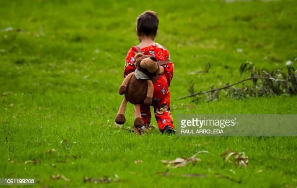 Venezuelan migrant toddler walks inside a humanitarian camp in Bogota on November 13 2018 Venezuelans migrants are transferred voluntarily to a...