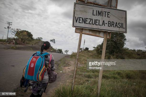 A Venezuelan migrant travels along a highway towards Pacaraima Roraima state Brazil on Thursday Feb 15 2018 Hundreds of thousands of Venezuelans...