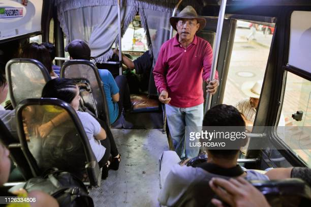 Venezuelan migrant Victor Roldan a former policeman sings for a living in a bus in Cucuta Colombia border with Venezuela on February 20 2019