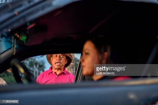TOPSHOT Venezuelan migrant Victor Roldan a former policeman sings for a living in Cucuta Colombia border with Venezuela on February 20 2019
