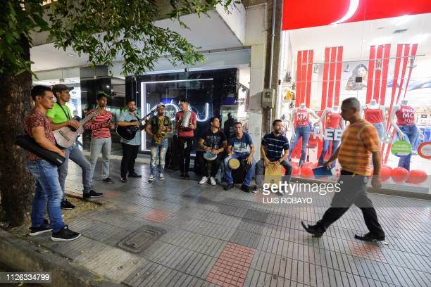 Venezuelan migrants and members of the musical orchestra Son de al lado play music for a living in the streets of Cucuta Colombia border with...