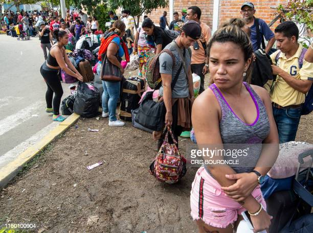 Venezuelan migrants arrive to get a refugee application at the Peruvian border post at the binational border attention centre in Tumbes, Peru on June...