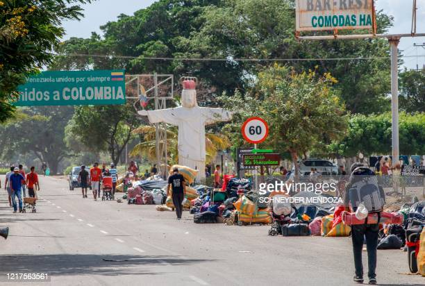 Venezuelan migrants attempting to return to their country due to the novel coronavirus COVID-19 pandemic, queue at the Simon Bolivar International...