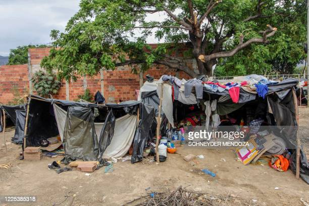 Venezuelan migrants attempting to return to their country due to the COVID-19 pandemic remain in makeshift camps at the Simon Bolivar International...