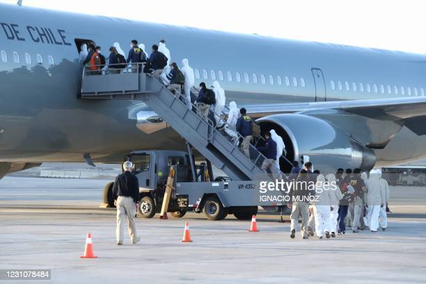 Venezuelan migrants board a plane as they are being deported after crossing illegaly through the border between Bolivia and Chile, at the General...
