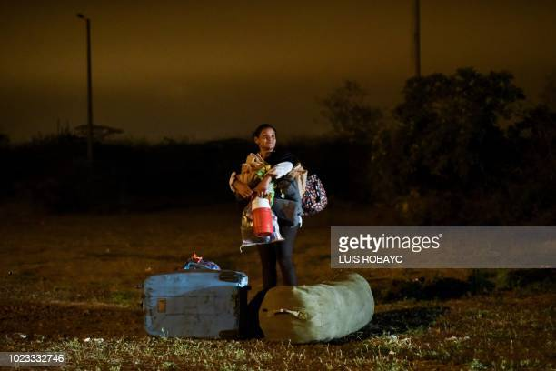 TOPSHOT Venezuelan migrants cross the border between Ecuador and Peru in Tumbes Peru on August 25 after touring Ecuador in buses facilitated by the...