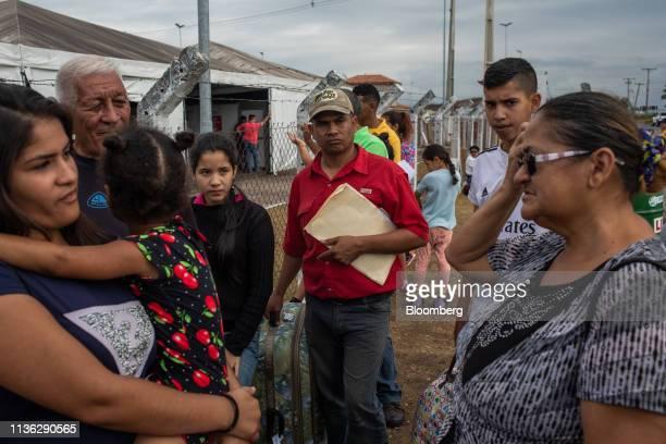 Venezuelan migrants gather at a refugee center near the Venezuelan border in Pacaraima, Brazil, on Wednesday, April 10, 2019. Venezuelan refugees...