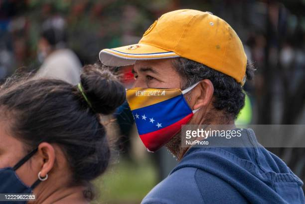 Venezuelan migrants in a Bogota, Colombia, on June 25, 2020. Facing travel restrictions and no work due to the economic shut down to curb COVID-19,...